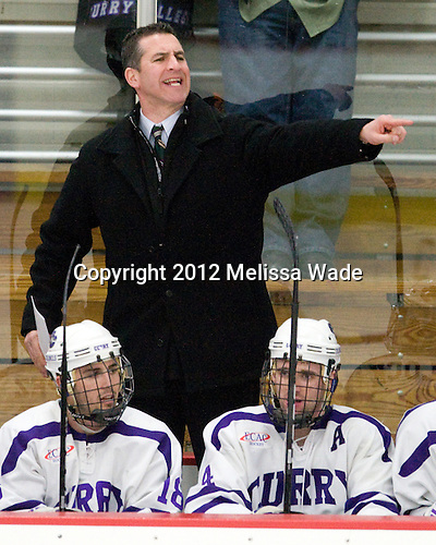Michael Lopez (Curry - 18), Larry Rooney (Curry - Assistant Coach), Mike Kavanagh (Curry - 4) - The Curry College Colonels defeated the Johnson & Wales University Wildcats 5-4 on Curry's senior night on Saturday, February 18, 2012, at Max Ulin Rink in Milton, Massachusetts.
