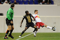 Seth Stammler (6) of the New York Red Bulls plays the ball under pressure from Danny Mwanga (10) of the Philadelphia Union. The New York Red Bulls defeated the Philadelphia Union 2-1 during a US Open Cup qualifier at Red Bull Arena in Harrison, NJ, on April 27, 2010.