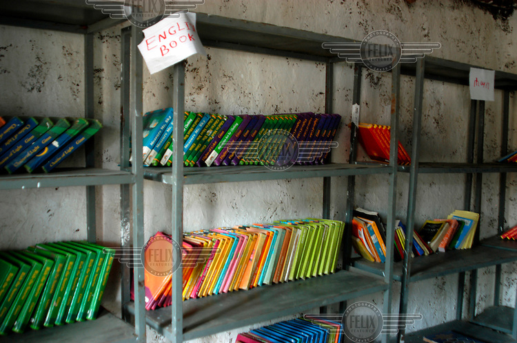 Shelves of English language books standing in the classroom of a local school.