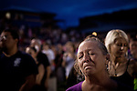 Tami Miller cries at  a vigil for the Granite Mountain Hotshots, 19 of who perished in the Yarnell Fire Sunday at Prescott High School in Prescott, Arizona, July 2, 2013.