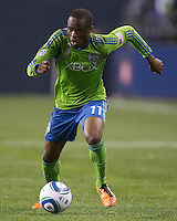 Seattle Sounders FC forward Steve Zakuani dribbles the ball up field during play against the Houston Dynamo at Qwest Field in Seattle Friday March 25, 2011. The match ended in a 1-1 draw.