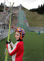 William Kalfoss smiles after a rare opportunity to try the new Midtstubakken ski jump. Starting out in smaller ski jumps in the forest nearby William wasn't even 14 when in Sept 2010 he got the chance to try the ski jump hill which will be part of the World Ski Championships in skiing in 2011. .Midtstubakken is part of the Holmenkollen Ski Jump arena and has been rebuilt and upgraded to host the 2011 Championships. .In addition five smaller recruitment hills with year round facilities will be built, which ski jumping enthusiasts hope will make sure the Norwegian national sport will survive. .FIS Nordic World Ski Championships 2011 will take place in Oslo from 23 February to 6 March 2011.