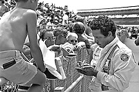 INDIANAPOLIS, IN - MAY 27: Danny Ongais signs autographs before practice for the Indy 500 at the Indianapolis Motor Speedway in Indianapolis, Indiana, on May 27, 1979.