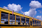 Yellow school bus at 4th of July parade wit American flags Burien Washington State USA .