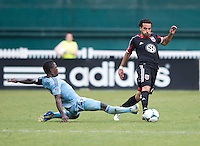 Dwayne De Rosario (7) of D.C. United steps away from the tackle of Mechack Jerome (24) of Sporting Kansas City during a Major League Soccer match at RFK Stadium in Washington, DC.  D.C. United tied Sporting Kansas City, 1-1.