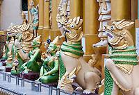 Myanmar, Burma.  Shwedagon Pagoda, Yangon, Rangoon.  Deities Encircling the base of the pagoda.