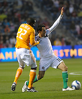 Houston midfielder Lovel Palmer (22) holds Chicago midfielder Marco Pappa (16).  The Chicago Fire defeated the Houston Dynamo 2-0 at Toyota Park in Bridgeview, IL on April 24, 2010.
