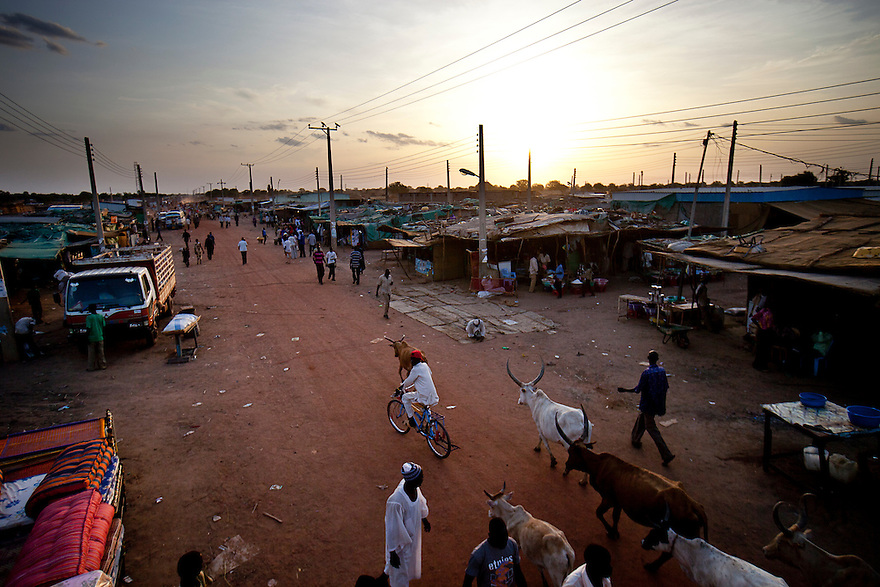 The market at a shanty town outside of Bentiu the capital of Unity state where most of South Sudan's oil is pumped on April 29, 2010. There is eletricity infrastructure, but no electricity and little money has reached the many poor who have settled around Bentiu hoping for work with oil companies.