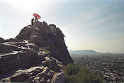 Pilgrims on top of 'Solomon's Throne' in the city of Osh, this rock has been a Muslim place of pilgrimage for many centuries, since the Prophet Mohammed prayed there.The city of Osh was once one of the great cities of the Silk Road and of Central Asia, and is the second biggest city in the country, situated in the unstable Ferghana valley which is now becoming a hotbed if Islamic Fundamentalism. Osh, Kyrgyzstan.