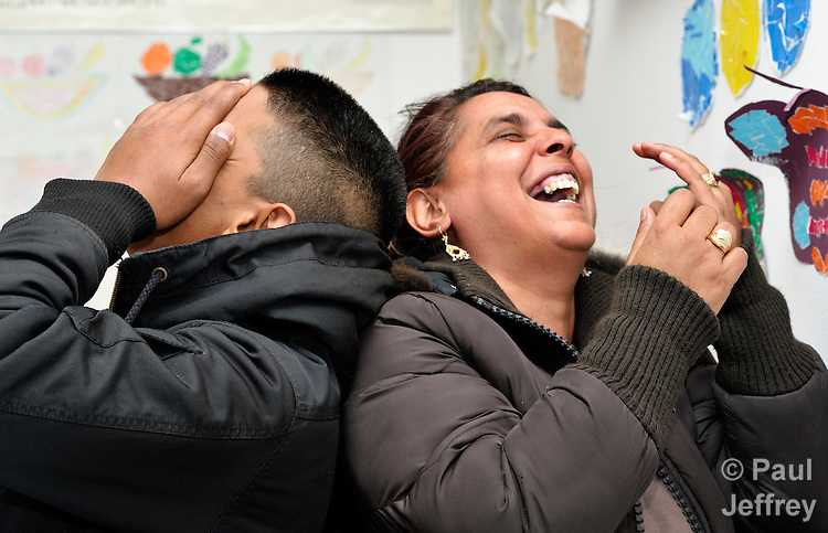 Two participants share a laugh during a basic literacy class for Roma adults in the Zemun Polje neighborhood of Belgrade, Serbia. The program is sponsored by the Branko Pesic School, which is supported by Church World Service. Many of the participants are refugees from Kosovo. Many lack legal status in Serbia, and thus have difficulty obtaining formal employment and accessing government services.