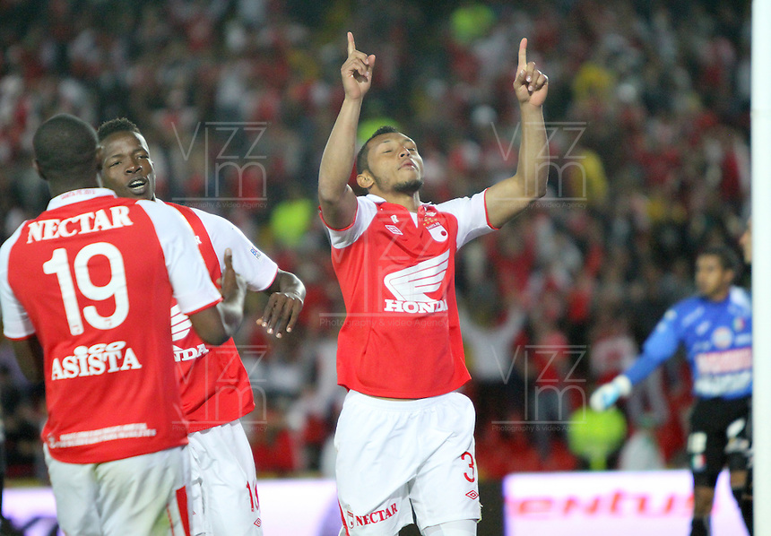 BOGOTA -COLOMBIA- 6 -10--2013. Carlos Valdes  de Independiente Santa Fe celebra su gol  contra el  Once Caldas, partido correspondiente a la catorceava  fecha de La Liga Postobon segundo semestre jugado en el estadio El Campin / CarlosValdes of Independiente Santa Fe celebrates his goal  against  Once Caldas, the fourteenth game in La Liga Postobon date second half played at El Campin.Photo: VizzorImage / Felipe Caicedo / Staff