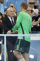 FIFA President Sepp Blatter congratulates Goalkeeper Manuel Neuer of Germany