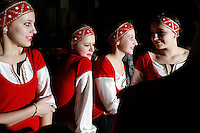 Teenage dancers wait backstage for their turn to perform during a Slavutych city concert. Slavutych, Ukraine, is the new city built after the accident to house evacuated Chernobyl personnel. The Chernobyl plant once funded many programs in the city. Now the city struggles with decreased resources due to layoffs at the Chernobyl plant. ..According to mayor Volodymyr Udovychenko, &quot;the year the Chernobyl nuclear power plant's last energy-producing unit was prematurely shutdown, Slavutych lived through a tragedy. A social tragedy.&quot; <br /> ------------------- <br /> This photograph is part of Michael Forster Rothbart's After Chernobyl documentary photography project.<br /> &copy; Michael Forster Rothbart 2007-2010.<br /> www.afterchernobyl.com<br /> www.mfrphoto.com <br /> 607-267-4893 o 607-432-5984<br /> 5 Draper St, Oneonta, NY 13820<br /> 86 Three Mile Pond Rd, Vassalboro, ME 04989<br /> info@mfrphoto.com<br /> Photo by: Michael Forster Rothbart<br /> Date:  2/2009    File#:  Canon 5D digital camera frame 54699<br /> ------------------- <br /> Original caption: .In Slavutych, Ukraine, teenage dancers wait backstage for their turn to perform during a city concert at the Kino-Concert Complex. The auditorium was full for the event organized by the Slavutych music school as a reprise of their successful concert in Kyiv...Slavutych is the new city built after the Chernobyl accident to house evacuated power plant workers and support personnel. The Chernobyl plant once funded many programs in the city. Now the city is struggling with decreased resources due to layoffs at the Chernobyl plant. Nevertheless, the community continues to put an emphasis on educational opportunities for their children. ..According to the mayor, Volodymyr Udovychenko, &quot;the year the Chernobyl nuclear power plant's last energy-producing unit was prematurely shutdown, Slavutych lived through a tragedy. A social tragedy.&quot; .-------------------