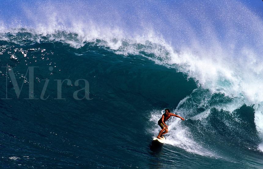 Hawaii. Hawaiian surfer on big wave.