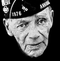 "Edward Hamilton (born 1917), an American veteran of World War II (WW2).  He trained at Westpoint military academy and was the battalion commander of the First Battalion of the 357th Infantry Regiment of the Ninth Infantry Division..""Our three mottos at Westpoint were Duty, Honour and Country, and I've always lived by those principles.  For me, cowardice is worse than death.  I've been wounded three times.  The last time, I got a piece of shrapnel in my face."".""As a commander, I had soldiers who wounded themselves so that they could go home.  For instance, there was someone who shot off his toe. I made sure that soldiers like that were court-martialled and sentenced to hard labour.  I had a company commander who didn't want to serve at the front any more.  He said that he was brave when it came to himself, but he had difficulty coping with the death of his subordinates.  I demoted him to the rank of private and sent him back to the front.  That way, he could show his courage without being burdened by the responsibility for others."".."