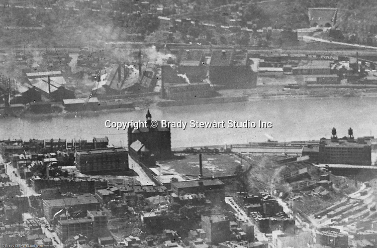 Pittsburgh PA:  View of the Duquesne University and the newly completed Liberty Tunnels on the South Side of Pittsburgh. Company - 1923.