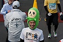 Feb. 28, 2010 - Tokyo, Japan - A runner wearing a Japanese character head costume smiles after the finish line during the 2010 Tokyo Marathon. Despite the cold and rain, more than 30,000 athletes participated in the event.