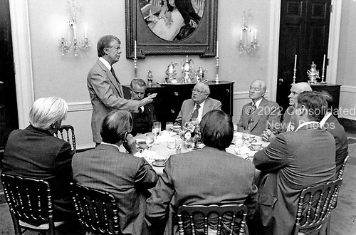 United States President Jimmy Carter addresses members of the Democratic Congressional Leadership breakfast in the first floor Private Dining Room of the White House in Washington, DC on January 25, 1977.  Visible from left to right: Speaker of the US House of Representatives Thomas P. &quot;Tip&quot; O'Neill (Democrat of Massachusetts), the President, US Senate Majority Leader Robert Byrd (Democrat of West Virginia), President pro tempore of the US Senate James O. Eastland (Democrat of Mississippi), First Deputy President pro tempore of the US Senate Hubert H. Humphrey, Jr. (Democrat of Minnesota), and US Senate Majority Whip Alan M. Cranston (Democrat of California).<br /> Credit: White House via CNP