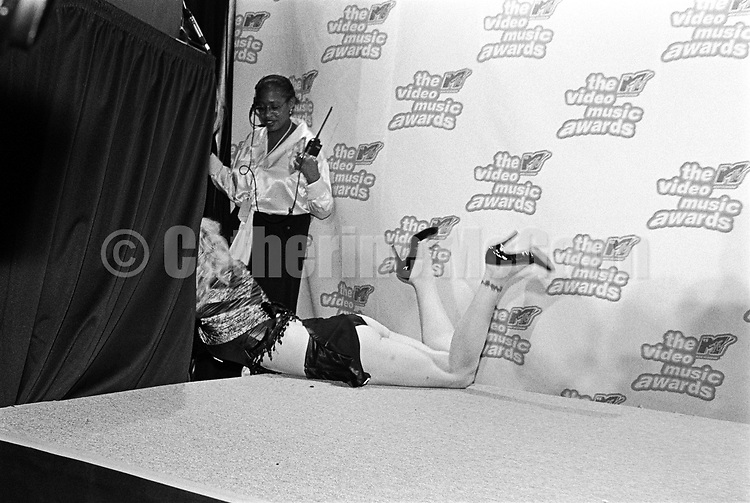 NEW YORK - SEPTEMBER 7:  American rock musician and actress, Courtney Love, is dragged off the press podium backstage at the 12th annual  MTV Awards on September 7, 1995 in New York City, New York. (Photo by Catherine McGann)Copyright 2010 Catherine McGann