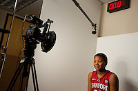 DENVER, CO--Amber Orrange smiles while ESPN filming during media day at the Pepsi Center for the 2012 NCAA Women's Final Four in Denver, CO.