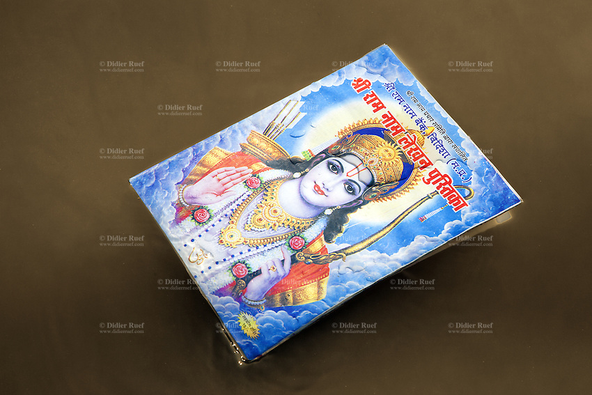 India. Uttar Pradesh state. Allahabad. Maha Kumbh Mela. A book to write the name of Lord Rama is floating on the river Ganges at Sangam. A person has filled the book with the name of Ram, once completed the book is plunged into the river as a blessing and a worship to the deities. Ram is the seventh avatar of the god Vishnu in Hinduism. The Kumbh Mela, believed to be the largest religious gathering is held every 12 years on the banks of the 'Sangam'- the confluence of the holy rivers Ganga, Yamuna and the mythical Saraswati. The Maha (great) Kumbh Mela, which comes after 12 Purna Kumbh Mela, or 144 years, is always held at Allahabad. Uttar Pradesh (abbreviated U.P.) is a state located in northern India. 9.02.13 © 2013 Didier Ruef