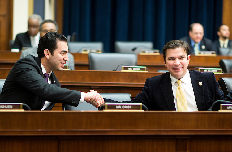 UNITED STATES - FEBRUARY 2: Rep. Ruben Kihuen, D-Nev., left, speaks with Rep. Vicente Gonzalez, D-Texas, during the House Financial Services Committee meeting to organize for the 115th Congress on Thursday, Feb. 2, 2017. (Photo By Bill Clark/CQ Roll Call)