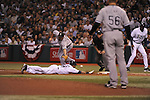 ST. PETERSBURG - OCTOBER 3:  Paul Konerko #14 of the Chicago White Sox can't handle the wild throw from Alexei Ramirez #10, allowing Willy Aybar to advance to third and eventually score in the 2nd inning of the game against the Tampa Bay Rays at Tropicana Field in St. Petersburg, FL on October 3, 2008.  The Rays defeated the White Sox 6-2.  (Photo by Ron Vesely)