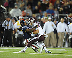 Ole Miss defensive back Charles Sawyer (3) tackled Texas A&amp;M quarterback Johnny Manziel (2) in Oxford, Miss. on Saturday, October 6, 2012. Texas A&amp;M won 30-27...