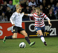 US midfielder Heather O'Reilly (9) defends against Germany's Babett Peter (4).  The U.S. Women's National Team tied Germany 1-1 in a friendly at Toyota Park in Bridgeview, IL on October 20, 2012.