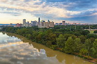 Looking at downtown Austin from the East Side of I-35, this image shows the skyline as morning storms fade from the area. Below the camera is Lady Bird Lake reflecting the clouds as they pass by.