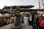 Palestinians watch an old canon that was found by Palestinian fishermen in the waters of the Mediterranean Sea in front of the Gaza Strip coast, at the main square in Deir al-Balah, central Gaza Strip, Thursday, Oct. 31, 2013. Palestinian officials said the canon is believed to have been erected on an enemy warship of the Ottoman Empire in the Mediterranean Sea. Photo by Ashraf Amra