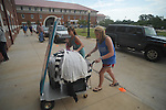 Annelise Albert (right), with her sister Mary Linley, moves items into a dorm at the University of Mississippi in Oxford, Miss. on Wednesday, August 17, 2011. Students have begun moving in for the fall semester of classes, which begin Monday, August 22, 2011.