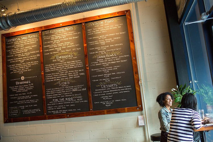 Durham, North Carolina - Thursday September 17, 2015 - Maya Freelon Asante talks with her friend, Annie Kao, while waiting for their order the evening of Thursday September 17, 2015 at Luna Rotisserie and Empanadas in Durham, North Carolina.