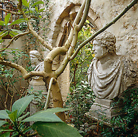 A pair of busts flank the arched entrance to the garden room