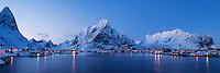 Snow covered Olstind mountain peak rising above Reine, Moskenesøy, Lofoten Islands, Norway