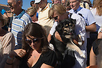 Woman with dog crowds of tourists, the  Accademia Bridge Venice Italy. 2009