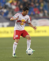 New York Red Bulls defender Kosuke Kimura (27) traps the ball. In a Major League Soccer (MLS) match, the New England Revolution (blue) tied New York Red Bulls (white), 1-1, at Gillette Stadium on May 11, 2013.