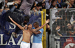 Calcio, Serie A: Lazio vs Palermo. Roma, stadio Olimpico, 2 settembre 2012..Lazio midfielder Antonio Candreva is hugged by teammate Abdoulay Konko, right, after scoring during the Italian Serie A football match between Lazio and Palermo at Rome's Olympic stadium, 2 September 2012..UPDATE IMAGES PRESS/Riccardo De Luca