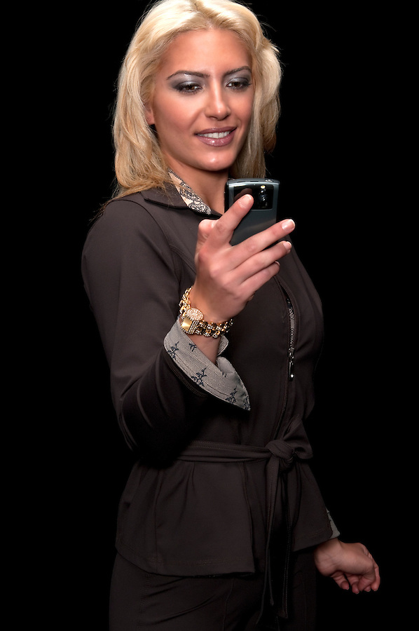 Young executive woman checking messages on her PDA.