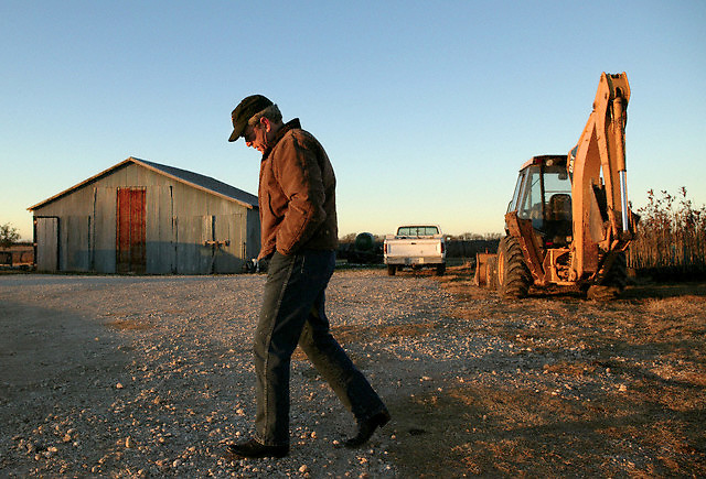 29 Dec 2003, Crawford, Texas, USA --- U.S. President George W. Bush takes a pensive walk around his ranch in Crawford, Texas. --- Image by © Brooks Kraft/Corbis