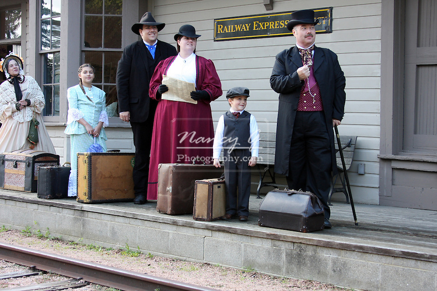 Travelers waiting for the train on a depot platform
