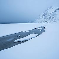 Snow covered Haukland beach in winter, Vestvågøy, Lofoten Islands, Norway
