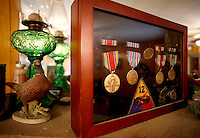 NWA Media/DAVID GOTTSCHALK - 8/27/14 - Medals earned by Quenton Skelton during his World War II service on display at his Springdale home Wednesday August 27, 2014. Skelton served in the Armored Division.