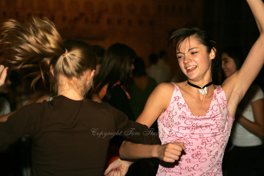 (R) Anna Bessonova and (L) Irina Kovalchuk of Ukraine dance during banquet after World Championships at Baku, Azerbaijan on October 9, 2005. Bessonova won silver in All-Around and Kovalchuk competed during team competition. (Photo by Tom Theobald)