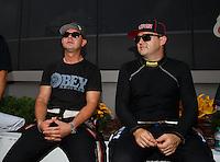 Sep 18, 2016; Concord, NC, USA; NHRA top fuel driver Steve Torrence (left) alongside Richie Crampton during the Carolina Nationals at zMax Dragway. Mandatory Credit: Mark J. Rebilas-USA TODAY Sports