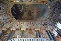 Saint Petersburg, Russia, August 2002..At the Hermitage, former home of the Tsars, and one of the world's great museums, an attendant is dwarfed by the scale of the entrance ceiling over the Jordan Staircase..