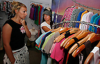 Marketing director for Roxy,  Stine Brun Kjeldaas, is a former snowboard professional and Olympic silver medalist. Here she (white t-shirt) is seen choosing outfits for a photo shoot with a colleague at Roxy Europe headquarters in Saint Jean de Luz, near Biarritz, France.
