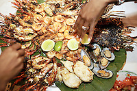 Dominican Republic. La Altagracia Province. Coastal resort of Punta Cana. Restaurant Captain Cook on the Playa Bavaro. El Cortecito. Parillada with fresh seafood, lobsters, shrimps, mussels and squids. © 2006 Didier Ruef