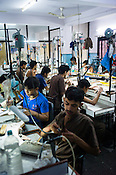 Workers making fine jewelry at the Di Gold Factory workshop in Johari Bazaar in Jaipur, Rajasthan, India.