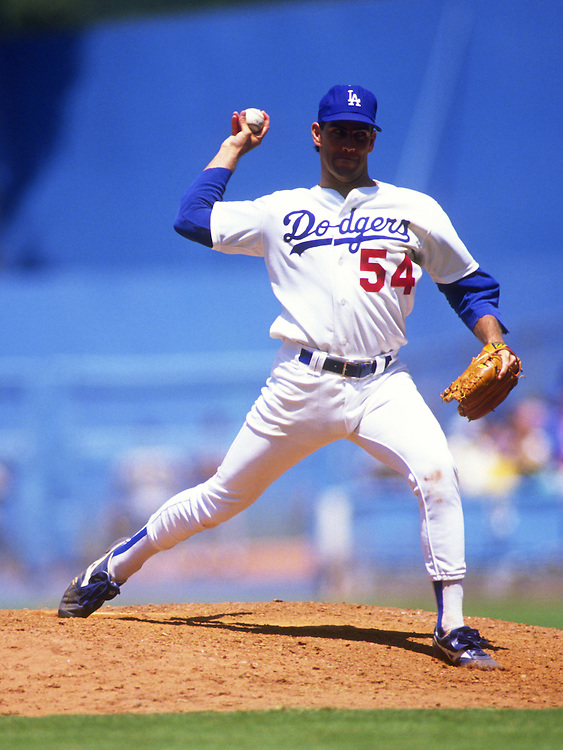 LOS ANGELES - JULY 1989:  Tim Leary #54 of the Los Angeles Dodgers pitches during an MLB game at Dodger Stadium during July, 1989. Leary played for the Dodgers from 1987-1989.  (Photo by Ron Vesely)   Subject: Tim Leary